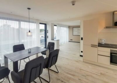 Kitchen and dining in penthouse | Avida Lofts
